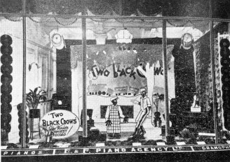 "Caption: ""The window display of the English and Foreign Piano Agency, Auckland, featuring ""The Two Black Crows."" This display caused a great deal of enthusiasm. The two figures themselves were in the middle of the display with electric light effect in the eyes."""